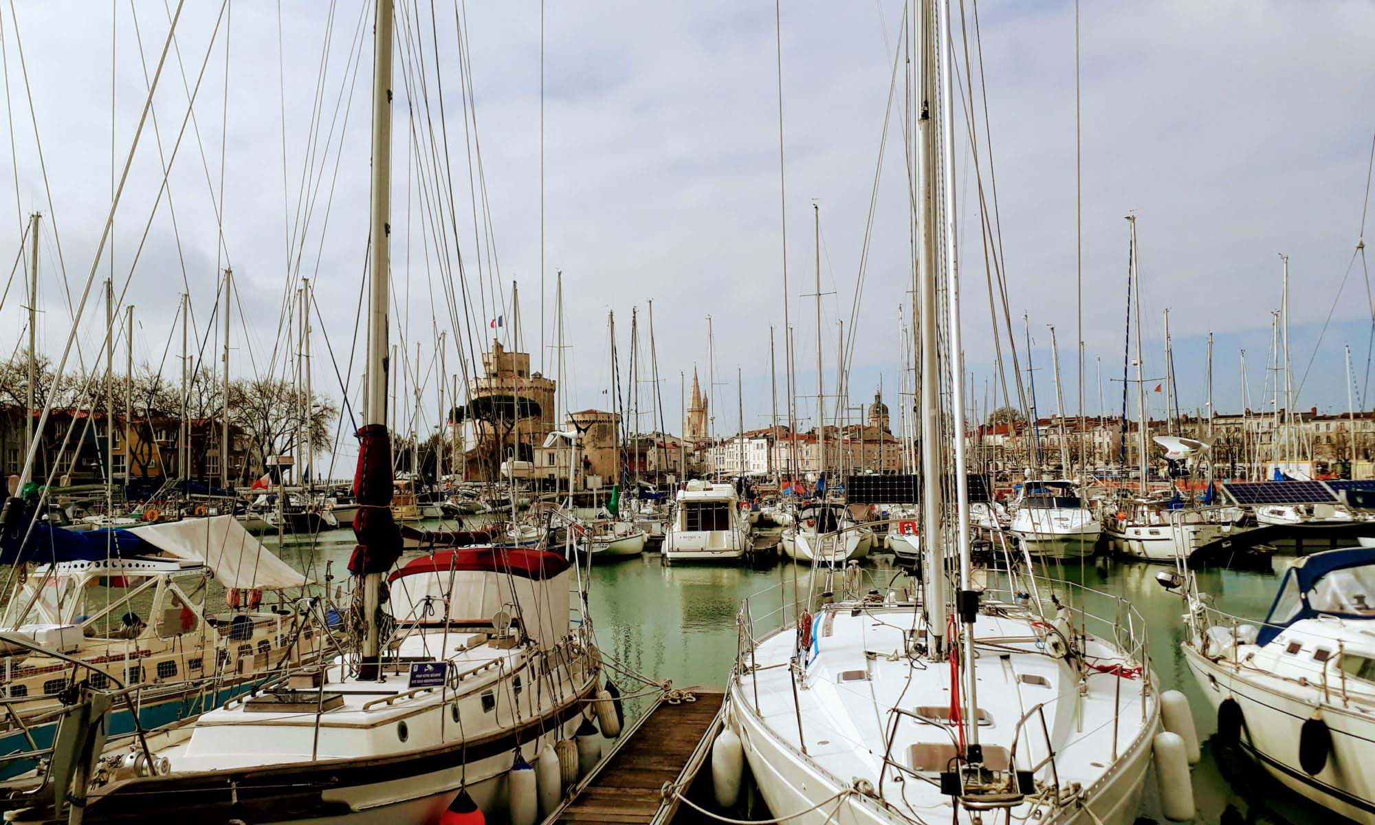 The old harbor (Le Vieux Port) of La Rochelle with the three towers