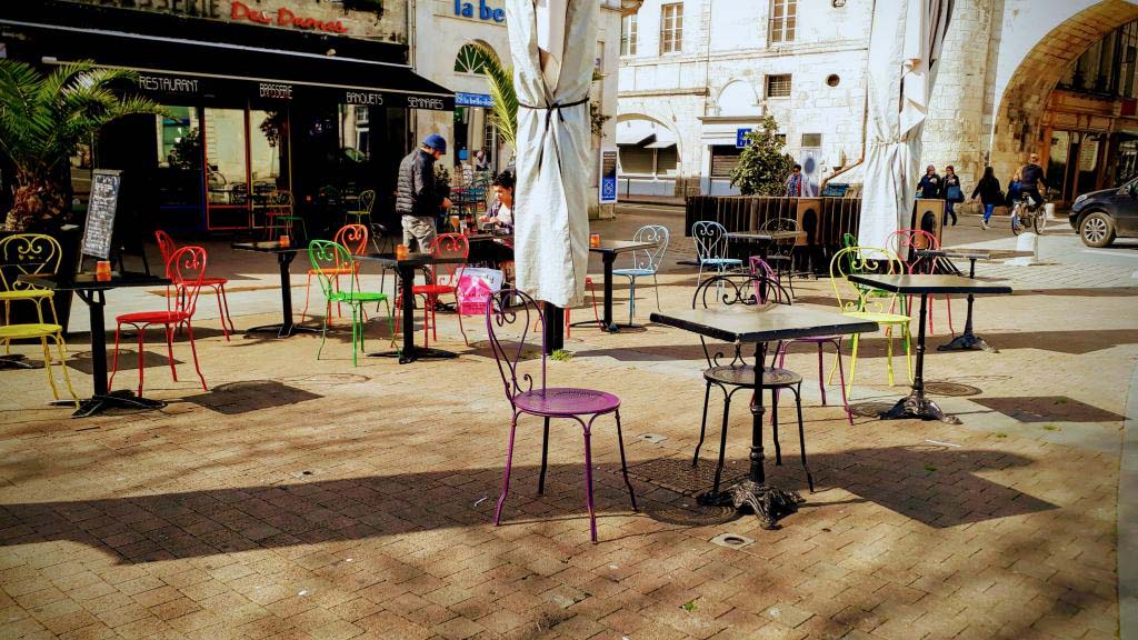Colorful chairs at the old harbor of La Rochelle