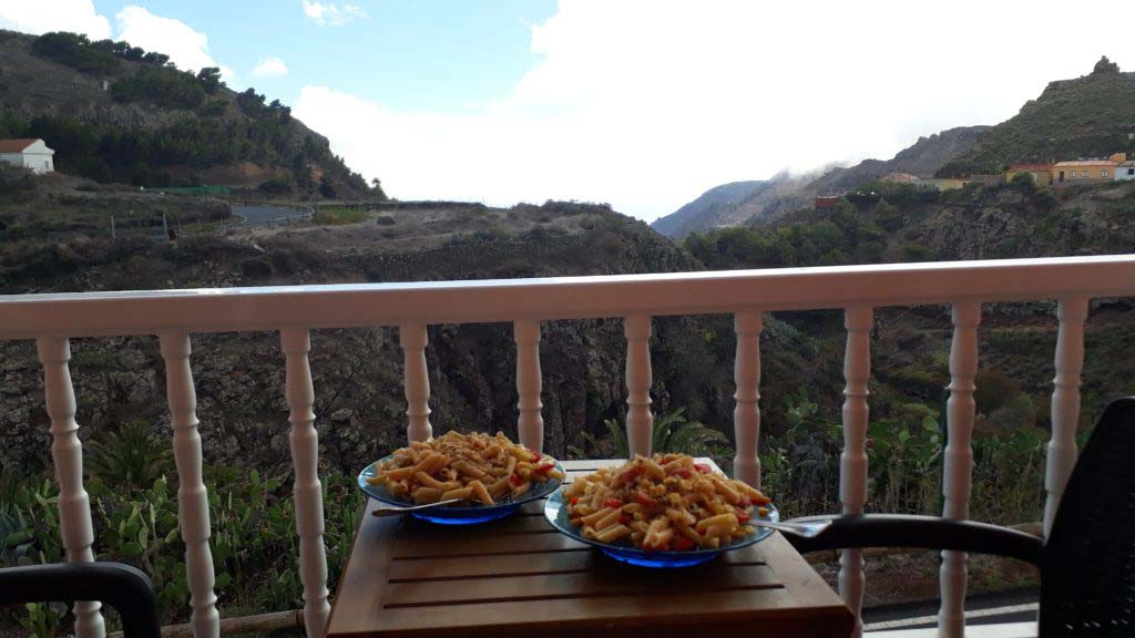 Home cooked meal on the balcony at Apartamentos Plaza Arure