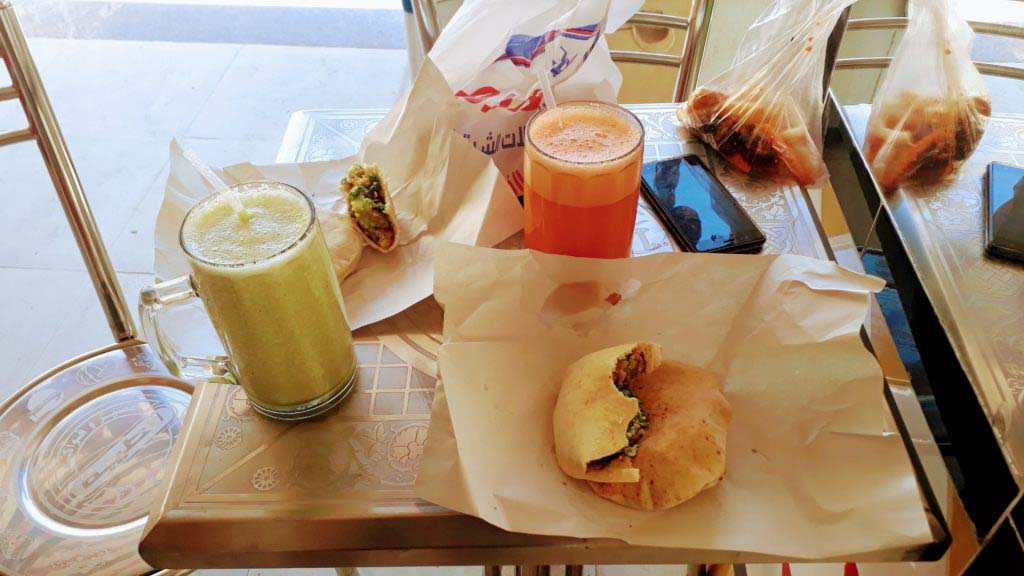 Breakfast in Arabic: Falafel sandwiches and freshly squeezed juices